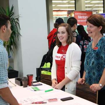 Photo of residents interacting with Brock staff at an information session