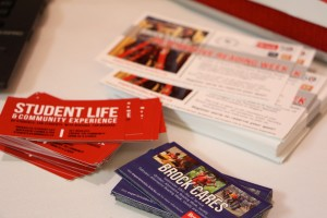 Photo of different business cards and stickers advertising different ways Brock students can contribute to the community.